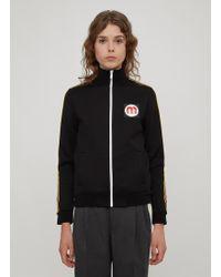 Miu Miu - Striped Rubber Logo Patch Track Top In Black - Lyst