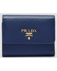 Prada - Saffiano Leather Fold-over Snap Stud Wallet In Blue - Lyst