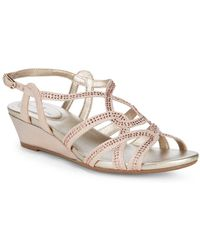 a244ac52d2cc Lyst - Bandolino Omit Wedge Cross Strap Sandal in Natural