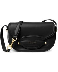 4f035c959b068 Lyst - Michael Michael Kors Luxury Pebble Leather Saddle Bag in Black