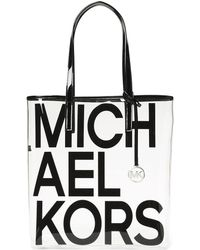 0b3f01fadf26 Jet Set Travel Tote. £215. Coggles · MICHAEL Michael Kors - The Michael Bag  Logo Printed Tote - Lyst