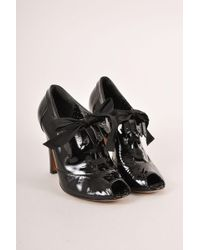 Boutique Moschino - Black Patent Leather Peep Toe Laced Kilty Booties - Lyst