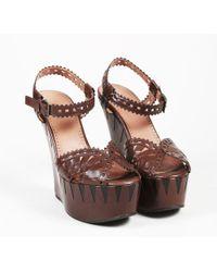 Alaïa - Brown & Black Leather Lasercut Wedge Sandals - Lyst