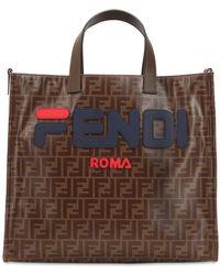 724096d81e Fendi - MANIA - Shopper in canvas con logo - Lyst