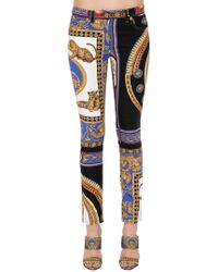 Versace - Printed Cotton Denim Jeans - Lyst