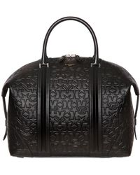 Givenchy - Star & Logo Embossed Leather Duffle Bag - Lyst