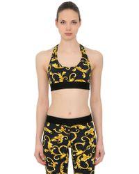 Versace - Printed Stretch Nylon Jersey Sports Bra - Lyst