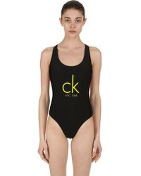 Calvin Klein - Cheeky Racerback One Piece Swimsuit - Lyst