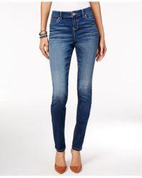 INC International Concepts - Beyond Stretch Indigo Wash Curvy Skinny Jeans - Lyst