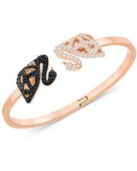 Swarovski - Gold-tone Pavé Swan Hinged Cuff Bracelet - Lyst