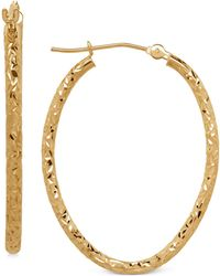Macy's - Oval Tube Hoop Earrings In 10k Gold, 1 3/8 Inch - Lyst