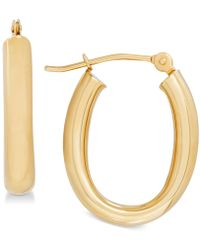 Macy's - Polished Tube Oval Hoop Earrings In 10k Gold - Lyst