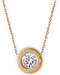 Michael Kors - Bezel Set Crystal Logo Pendant Necklace - Lyst