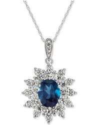 Macy's - Blue Topaz (1-1/2 Ct. T.w.) & Diamond (1/10 Ct. T.w.) Pendant Necklace In 14k White Gold - Lyst