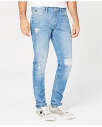 Guess - Slim-fit Tapered-leg Stretch Destroyed Jeans - Lyst