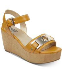 0aef757c2a58 Lyst - G by Guess Dodge Platform Wedge Sandals in Metallic