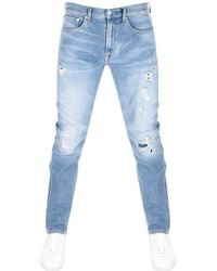 Calvin Klein - 056 Athletic Taper Jeans Blue - Lyst