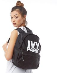a3c4c371377c TOPSHOP Coated Canvas Backpack in Metallic - Lyst
