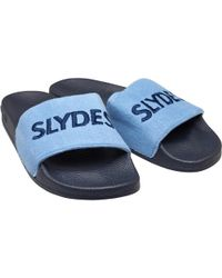 d0598ca53d898 Slydes Fin Logo Strap Slider Flip Flops in Black for Men - Lyst