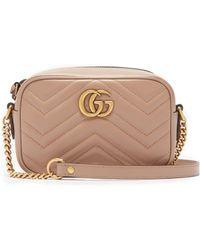 b951e75a3a7 Gucci Gg Marmont Mini Quilted Leather Cross-body Bag in Pink - Lyst