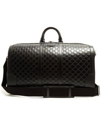 Gucci - Gg-debossed Leather Holdall - Lyst
