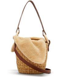 Muuñ - Seau Shearling And Woven-straw Bucket Bag - Lyst