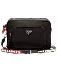f6cb4be5c16b Prada - New Vela Mini Studded Nylon Cross Body Bag - Lyst