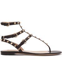 Valentino - Rockstud Flat Leather Sandals - Lyst