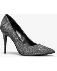 4039d5964dec Lyst - Michael Kors Claire Black   Gold Glitter Mesh Pumps in Metallic