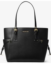 cb7370fd2 ... ireland michael kors voyager east west black saffiano leather tote bag  lyst 5f288 f0e7d