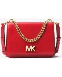 b150cfceb350 MICHAEL Michael Kors Mott Leather Crossbody Bag in Pink - Save 55 ...