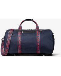 f99cddca728cc Lyst - Michael Kors Signature Logo Jet Set Travel Duffle Bag in ...