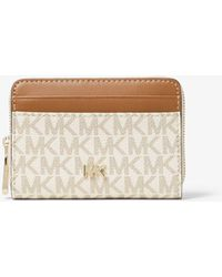 1383f6188fc MICHAEL Michael Kors Greenwich Leather Wallet in Pink - Lyst