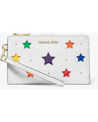 MICHAEL Michael Kors - Adele Star-cutout Pebbled Leather Smartphone Wallet - Lyst