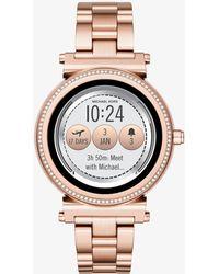 Michael Kors - Smartwatch Sofie tonalità oro rosa con pavé - Lyst