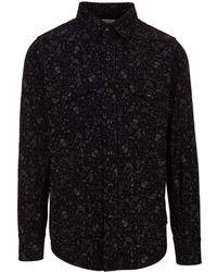 Saint Laurent - Camicia nera in seta con micro teschi stampati e taschini chiusi da un bottone a pressione - Lyst