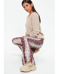 Missguided - Burgundy Snake Print Flare Trousers - Lyst