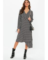 8e21ef13df2 Missguided - Black Wrap Front Balloon Sleeve Stripe Dress - Lyst