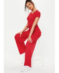 8678d1a319c Lyst - Missguided Red Ribbed Cropped Jumpsuit in Red