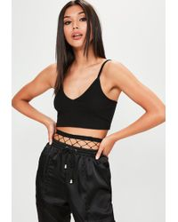 25a6113479c77b Missguided - Petite Exclusive Black Ribbed Cami Crop Top - Lyst