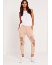 Missguided - Extreme Distressed Knee Joggers Nude - Lyst