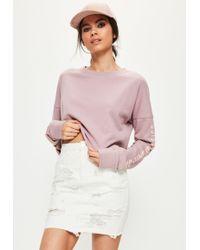 95a013649 Missguided - Cream Distressed Denim Mini Skirt - Lyst