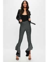 Missguided - Black Metallic Striped Asymmetric Frill Side Cigarette Pants - Lyst