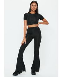 Missguided - Black Shiny Ribbed Flare Pants - Lyst