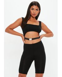 Missguided - Black Buckle Cut Out Unitard - Lyst