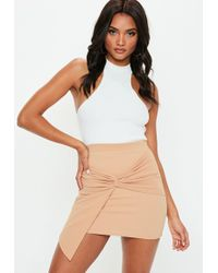 b0571fbb00 Missguided - Nude Knot Front Scuba Crepe Mini Skirt - Lyst