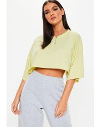 16606417471c8e Missguided - Yellow Drop Shoulder Oversized Crop Top - Lyst