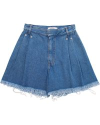 Ksenia Schnaider - Medium Wash Frayed Denim Shorts - Lyst