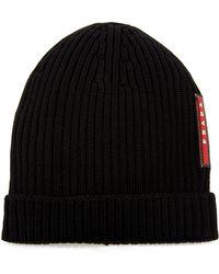 Prada - Logo-appliquéd Ribbed Wool Beanie - Lyst