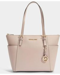 MICHAEL Michael Kors - Jet Set Item East-west Top Zip Tote Bag In Soft Pink Saffia Leather - Lyst